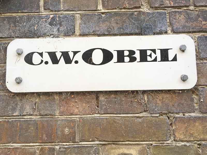 Skilt fra C. W. Obels tobaksfabrik i Aalborg